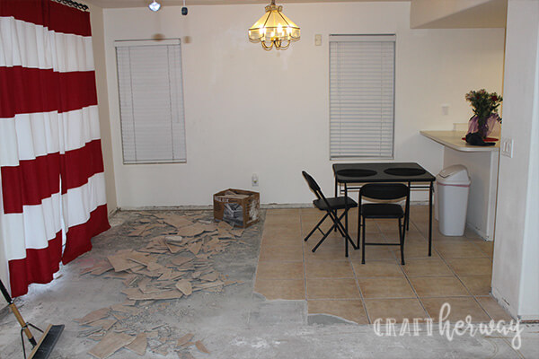 kitchen with partially removed tile