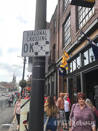 honky tonk row on broadway in downtown nashville with diagonal crossing - 9 things to do in Nashville