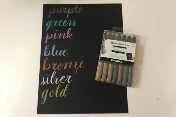 Zebra metallic brush pen color swatch on black paper